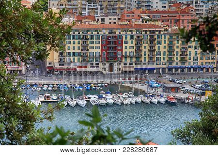 Nice, France - May 14, 2013: Yachts And Architecture In The Port De Nice In French Riviera, France.