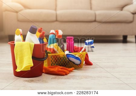 Bucket With Sponges, Chemicals Bottles, Brushes, Towel And Rubber Gloves. Household Equipment, Sprin