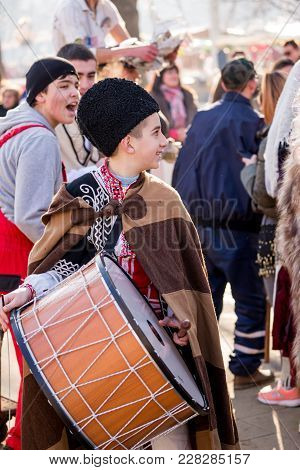 Pernik, Bulgaria - January 26, 2018: Boy Plays Loud Drum Music And Has Fun With Other Musicians Of H