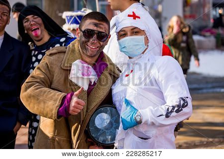 Pernik, Bulgaria - January 26, 2018: Two Artists Teens With Costumes Of Patient And Nurse Pose Smili