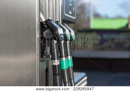 Fuel Pump Filling Nozzles For Petrol And Diesel At A Gasoline Station, Copy Space, Selected Focus
