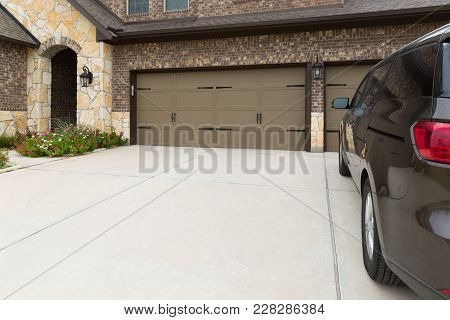 View On A House Garage From The Car Side. Parking Place Near A House And Entrance To The House With