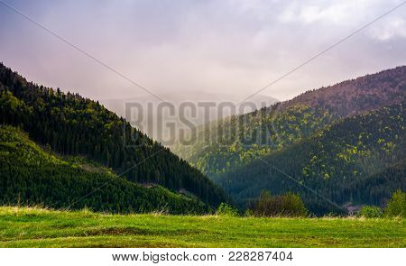 Mountains On A Cloudy Springtime Day. Beautiful Nature Scenery With Forested Hills