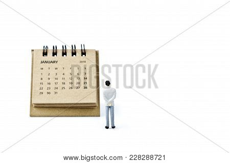January. Two Thousand Eighteen Year Calendar And Miniature Plastic Man On White Background.