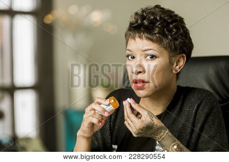 Secretive Woman Holding An Opioid Pill Bottle