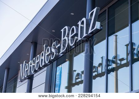 Fuerth / Germany - February 25, 2018: Mercedes-benz Logo Hangs On A Car Dealer Building. Mercedes-be