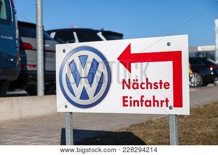 Fuerth / Germany - February 25, 2018: Volkswagen Logo Near A Car Dealer. Naechste Einfahrt Means Nex