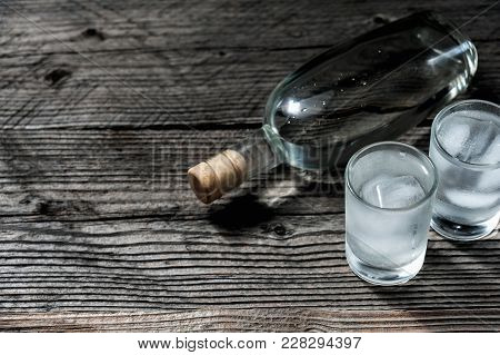 Two Shot Glasses With Cold Vodka Or Gin On Wooden Table, Copyspace.