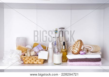 Spa And Wellness Setting With Soaps, Candle, Oil And Towels On A Shelf In Light Interior . Dayspa Na