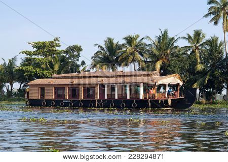 Alleppey, India - November 6, 2016: Tourists On Houseboat Floating On Backwaters In Kerala State, So