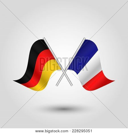Vector Two Crossed German And French Flags On Silver Sticks - Symbol Of Germany And France