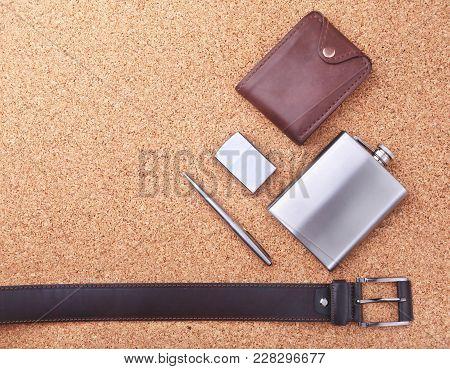 Gadgets And Accessories For Men On Light Wooden Background. Fashionable Men S Belt, Wallet, Lighter,