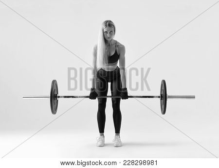 Black And White Front View Of Confident Young Blonde Woman Doing Weight Lifting Workout Attractive Y
