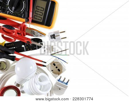 Close-up Of Work Tools And Electrical Equipment On A White Background With Space For Text / Announce