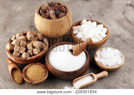 Various Types Of Sugar, Brown Sugar And White On Table