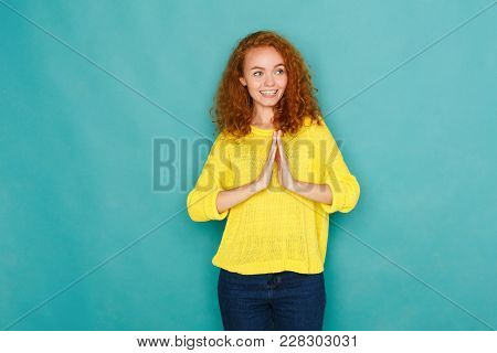 Cheerful Relaxed Woman With Happy Face, Showing Welcome And Thank You Hand Sign, Standing On Blue St