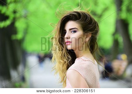 Spring, Youth, Freshness. Sensual Woman In Spring Park. Girl With Makeup, Long Hair, Beauty. Hair Ca