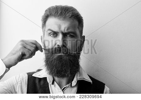 Bearded Man, Long Beard, Brutal Caucasian Hipster With Moustache With Serious Face In Shirt And Brow