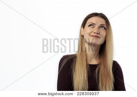 Close-up Portrait Of A Casual Pretty Young Smiling Girl Thinking About Something Isolated On The Whi