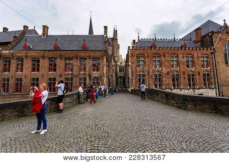 Bruges, Belgium - June 10, 2014: Tourists Taking Pictures In Eautiful Street In Bruges, Belgium. Bru