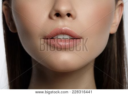 Close Up Of Voluptuous Female Lips With Pink Skin. Woman Is Expressing Desire