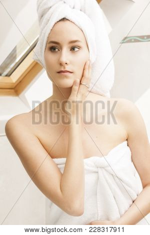 Young Woman Fresh From Shower, Wrapped With White Towels, Looking Herself At The Mirror In The Bathr