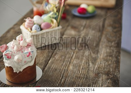 Close Up Of Sweet Bread And Box With Colored Eggs On The Timbered Desk. Focus On Bakery. Copy Space