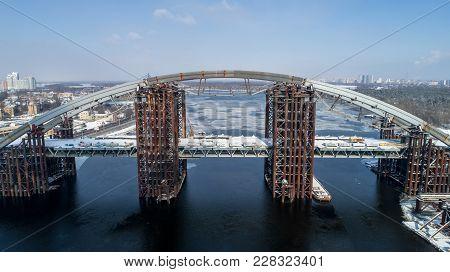 Rusty Unfinished Bridge In Kiev, Ukraine. Combined Car And Subway Bridge Under Construction. Mountin