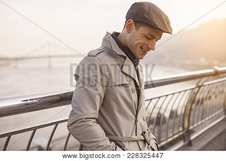 I Feel Good. Side View Profile Of Cheerful Stylish Guy Is Standing On Street And Looking Down With S