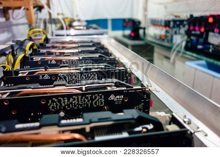 KYIV, UKRAINE - FEBRUARY 26, 2018: local mini mining farm works both for cryptocurrency and as heate