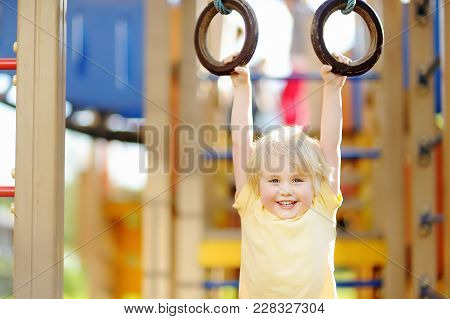 Little Boy Having Fun On Outdoor Playground. Summer Active Sport Leisure For Kids. Kindergarten Or S