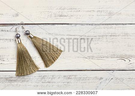 Beige Tassel Earrings On White Background, Copy Space