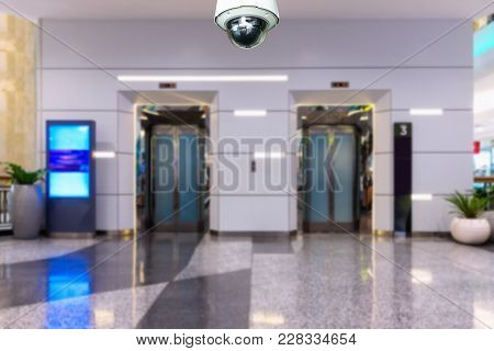 Cctv Security Camera Observation And Monitoring Front Of Elevator In Department Store.