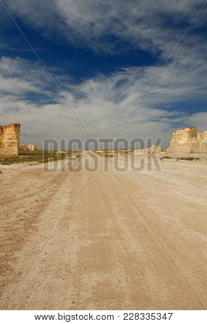 The Gravel Road That Leads To Monument Rocks, The Chalk Pyramids In  Kansas.