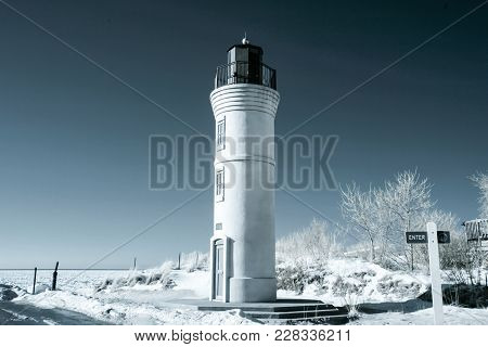 Manning Memorial Lighthouse On Sandy Lake Michigan Beach  In Infrared With Blue Tones
