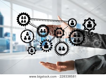 Business Woman In Black Suit Keeping Black Social Gear Icons In Hands With Office View On Background