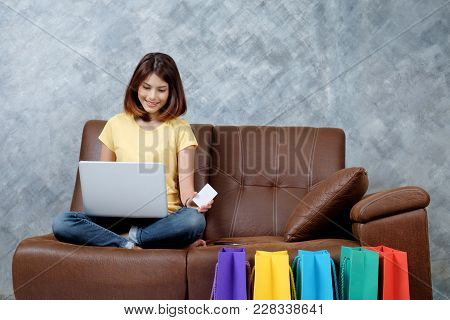 Woman Shopping Online. Holding Blank Credit Card.