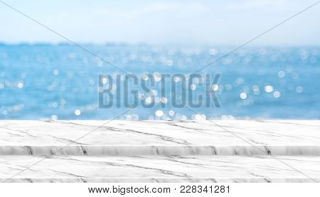 Empty White Marble Table Top With Blur Blue Sky And Sea Boekh Background In Sunny Day,mock Up Templa