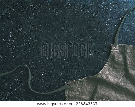Cooking And Kitchen Background - Trendy Denim Cotton Apron On Dark Background With Copy Space. Gray