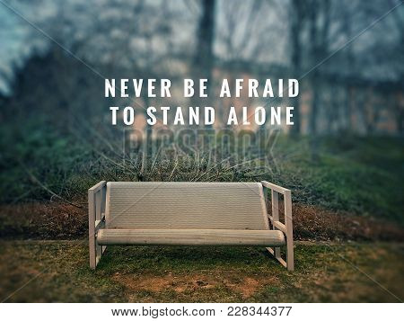 Motivational And Inspirational Quotes - Never Be Afraid To Stand Alone. With Blurred Vintage Styled