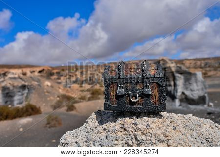 Conceptual Photo Picture Of A Treasure Trunk Object In The Dry Desert