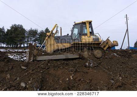 An Excavator Working Removing Earth On A Construction Site