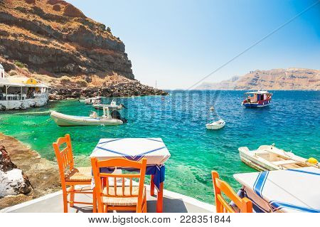 Cafe On The Sea Coast In The Port Of Santorini Island, Greece.