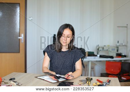 Female Making Black Leather Women Bag. Girl Likes Handicraft And Attending Sewing Circle. Lady With