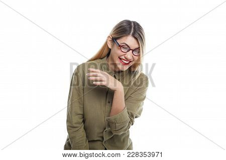 Isolated Shot Of Cheerful Emotional Beautiful Hispter Girl Laughing Out Loud At Funny Joke While Wat