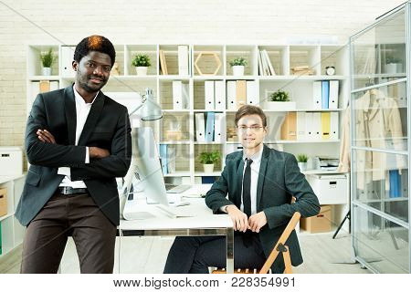 Multi-ethnic Team Of White Collar Workers Wearing Stylish Suits Posing For Photography While Gathere