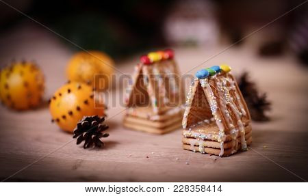 Christmas Kitchen. Background Image Cookies And Oranges On The Table.photo With Copy Space