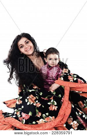 Gypsy Family.mother And Son.the National Costume.ethnic Culture.the Photo With Blank Space For Text