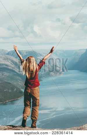 Happy Woman traveling in Norway emotional raised hands adventure Lifestyle wanderlust vacations outdoor success wellness concept poster