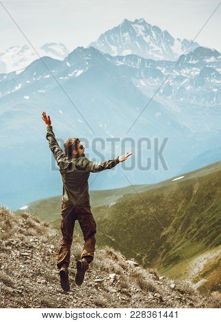 Happy Man Jumping Levitation In Mountains Lifestyle Travel Emotional Success Concept Adventure Activ